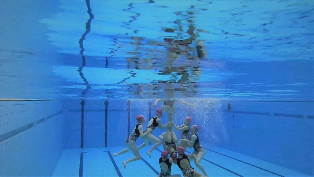 An underwater view of Edinburgh Synchro swimmers performing a lift - without touching the floor!